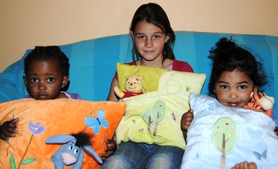 Pre-school children playing with pillows.