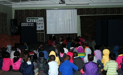 Our audio-visual system includes a projector and a large screen for the children to watch educational videos and more.